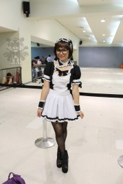 Cute girl in an anime-inspired maid costume