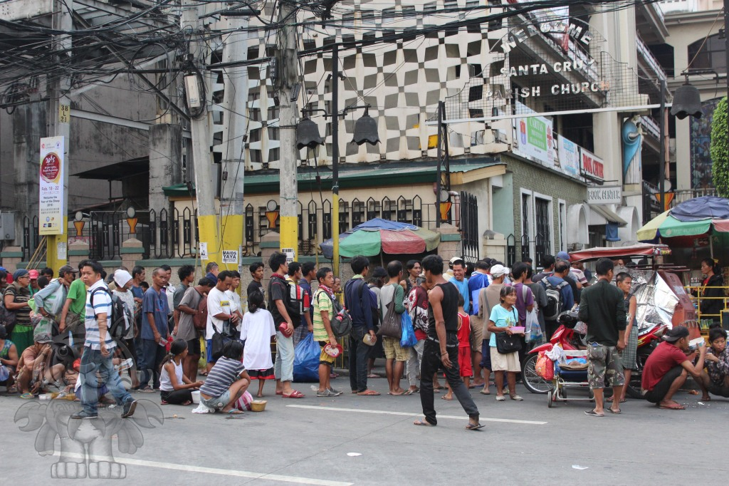 Beggars and Homeless people gather and form a line in front of the church in the other side of the  fountain. The taho vendor said that the church offer free Arroz Caldo (porridge with chicken meat, known food here in the Philippines) to the homeless every friday, saturday and on holidays