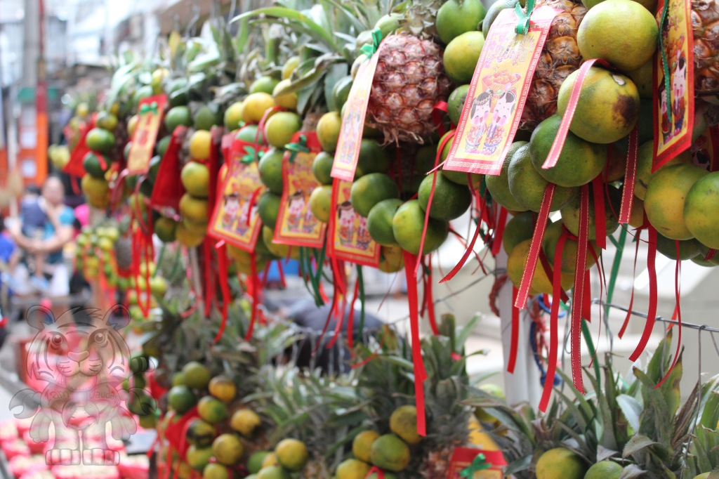 Fruits with what appears to ampaos, being sold along the streets