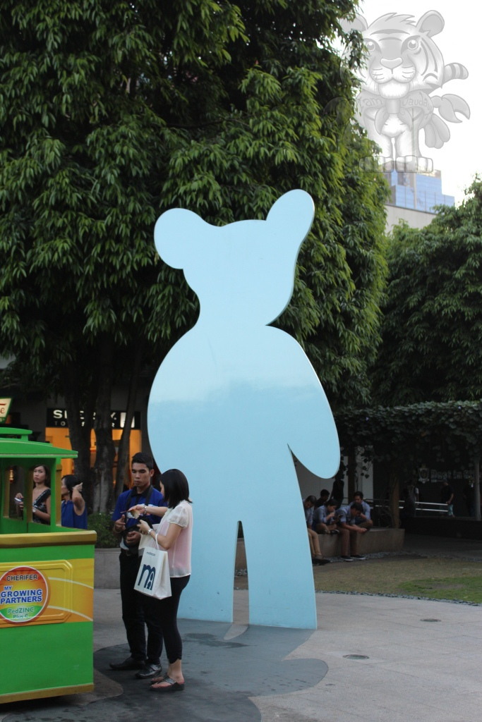 A teddy-like silhouette giant standee.