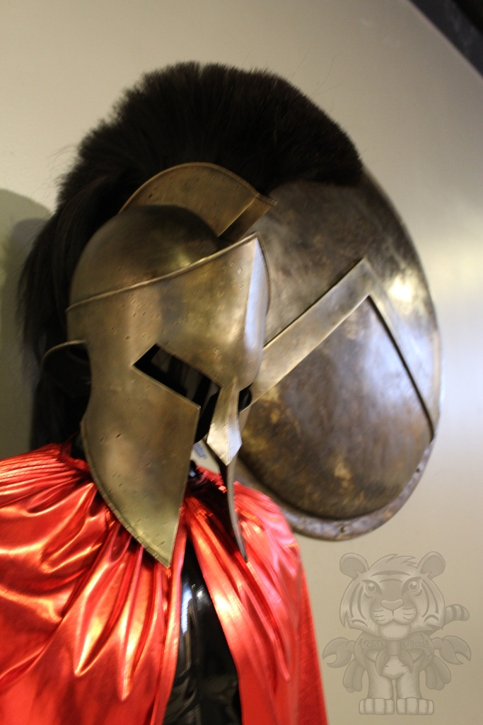 Leonidas' helmet, cloak, and shield.
