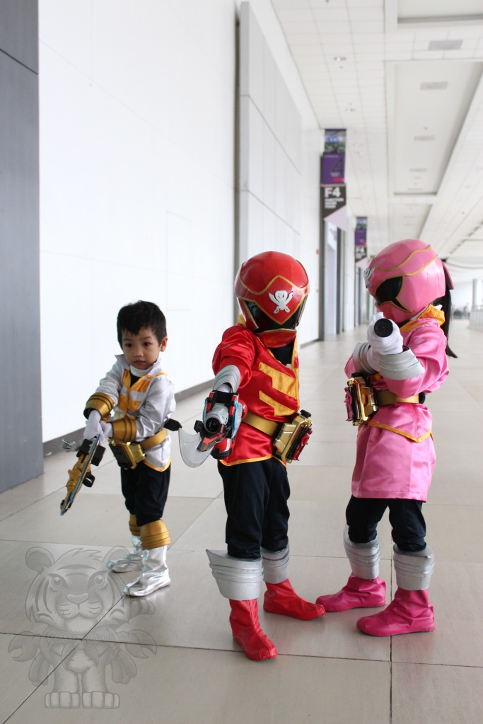 Even cute kids like to cosplay. White, Red, and Pink Ranger of Power Rangers Super Megaforce.