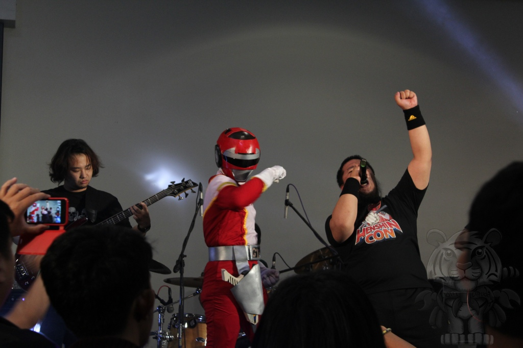 Red ranger joined in as the band performed the Opening song of Turbo Rangers.