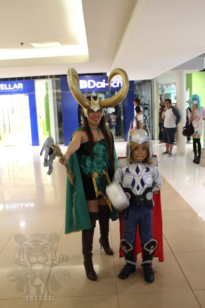 Lady Loki and kid Thor.