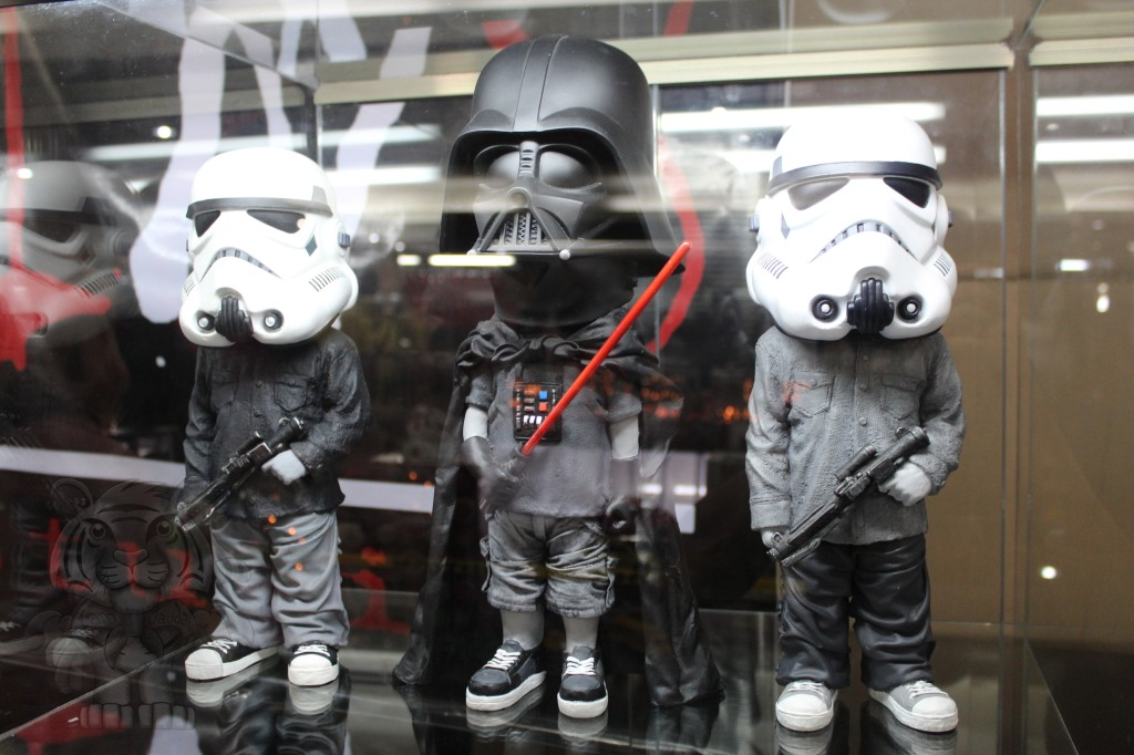 A chibi Darth Vader and his storm troopers.
